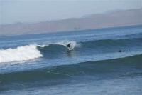 surfers bij Morro Rock